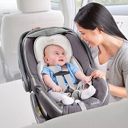 Baby head support in car seat.